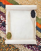Old paper for menu on lentils, beans, peas, soybeans, legumes with spoons textured background — Stock Photo