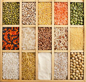 Variation of lentils, beans, peas, grain, groats, soybeans, legumes in wooden box — Stock Photo