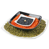 Red and black lentil , green mung soya beans in plate dish — Stock Photo