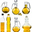 Olive and sunflower oil in the bottles and decanters isolated on white background - Stock Photo
