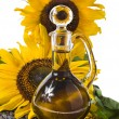 Sunflowers seeds and glass bottle oil — Stock Photo #14127849
