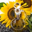 Sunflowers seeds and glass bottle oil — Stock Photo #14127853
