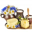 Dairy products on the wooden board table on white background — Stock Photo