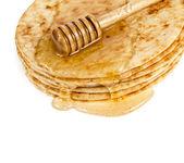 Pancakes with honey isolated on white — Stock Photo