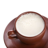Milk drink in a brown ceramic cup isolated on white — Stock Photo