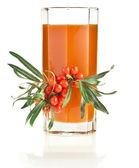 Sea buckthorn berries juice on the glass — Stock Photo