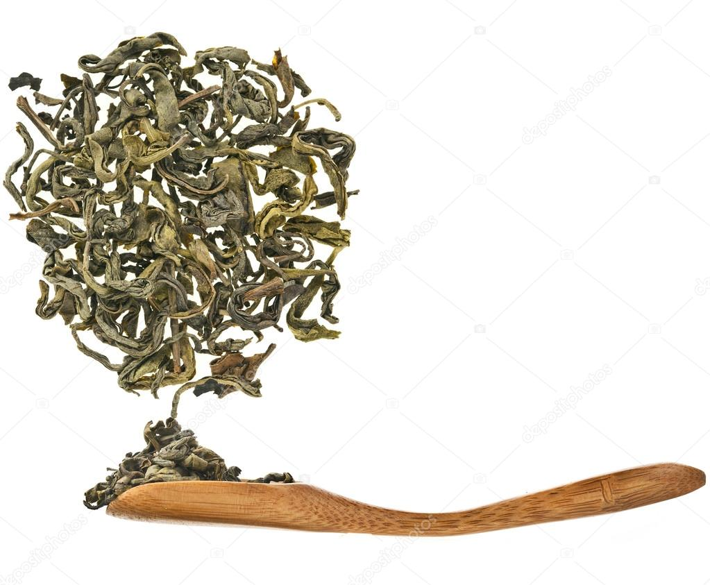 Green tea leaves and wooden spoon isolated on white background — Stock Photo #14159571