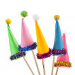Party hat isolated on wooden sticks — Stock Photo