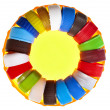 Circle of colorful plastic bottle caps isolated on white - Stock Photo