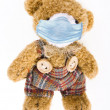Teddy bear with protective face mask - Stock Photo