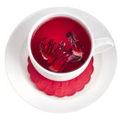 Hibiscus flower tea in tea cup isolated on white background — Stock Photo