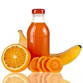 A bottle juice of fresh orange, carrot, banana, iIsolated on white background — Stock Photo