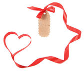 Cardboard tags with red heart ribbon bow — Stock Photo