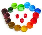 Colorful plastic bottle caps isolated on white — Stock Photo