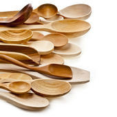Assorted different kitchen wooden utensils cutlery on a white background — Stock Photo