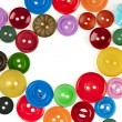 Stock Photo: Many color buttons on white background
