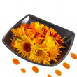 Royalty-Free Stock Photo: Herbal calendula in black bowl and oil drop Isolated white background