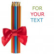 Color pencils with red ribbon bow isolated on white — Stock Photo