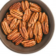 Peeled pecan nuts inthe bowl, isolated on white background - Stockfoto