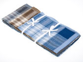 Pack new handkerchiefs with ribbon bow — Stock Photo