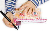 Child painting on paper the house — Stock Photo