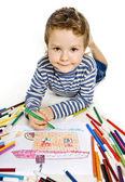 绘制一个房子的男孩 — 图库照片