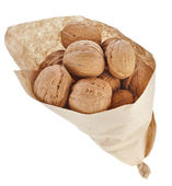 Walnut isolated in paper bag on white background — Stock Photo