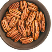 Peeled pecan nuts inthe bowl, isolated on white background — Stock Photo