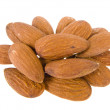 Macro almond salted isolated on a white — Stock Photo
