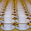 Many rows of pure white cup and saucer — Stock Photo #14381413