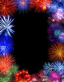 Beautiful fireworks exploding over a dark night sky with copy space — Stock Photo