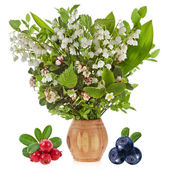 Bouquet of lilies-of-the-valle with bloom blueberries cowberries on birch vase — Stock Photo