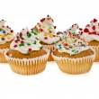Cupcakes with colorful sprinkles on white background — Stock Photo
