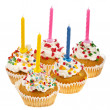 Birthday cupcakes with colorful sweet sprinkles and candle on white background — Stock Photo #14459923