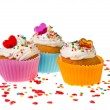 Cupcakes with colorful sprinkles on white background — Stock Photo #14459949