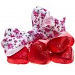 Heart candies with ribbon bow on white background — Stock Photo