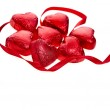 Chocolate heart candies on white background — Stock Photo