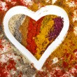 Heart Shape of Colorful Spice Powder Mix Surface — Stock Photo
