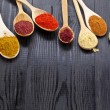 Powder spices on wooden spoons - Foto Stock