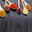 Powder spices on wooden spoons - Stock Photo