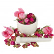 Buds of the tea roses flowers in a mortar and pestle — Stock Photo #14461881