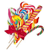 Colorful lollipop with red ribbon bow isolated on white — Stock Photo