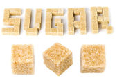 "The word ""sugar"" composed of pieces of cane sugar — Stock Photo"