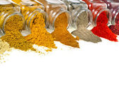 Border of colorful powder spices in glass bottle isolated — Stock Photo