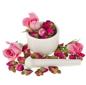 Buds of the tea roses flowers in a mortar and pestle — Stock Photo