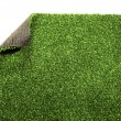 Artificial grass meadow lawn plastic background texture — Stock Photo