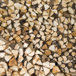 Stack of fresh firewood - Stock Photo