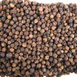 Black pepper on a white background — Stock Photo