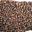 Black pepper on a white background - Stock Photo