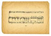 Página de hoja con textura música antigua sobre fondo blanco — Foto de Stock
